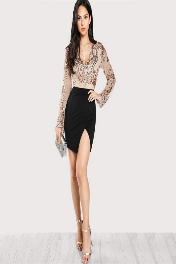 Long sleeve sequined mesh body suit.The sequined mesh is stretchy.